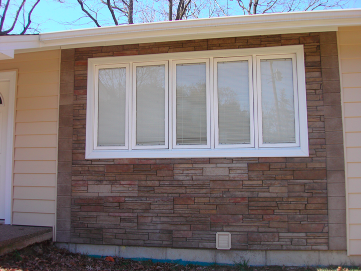 Stone siding surrounding the window frame.png