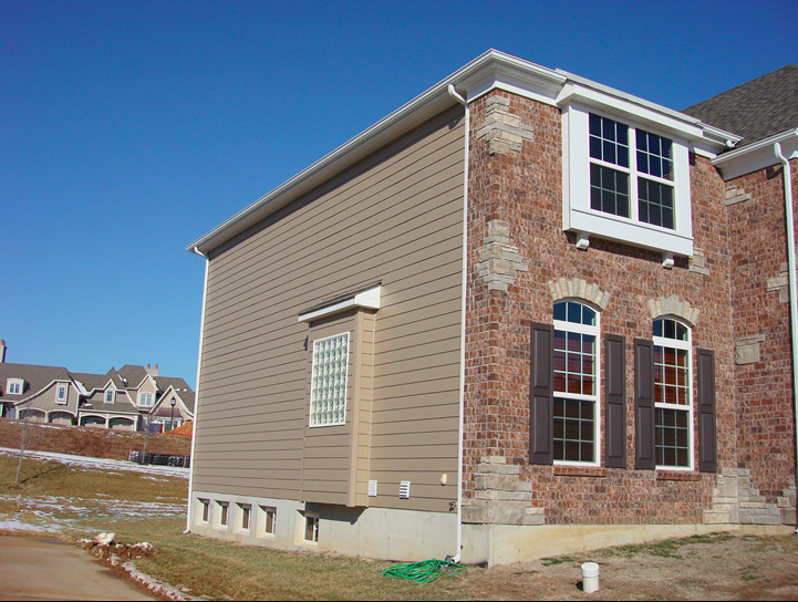 Hardie board with stone and brick siding.png