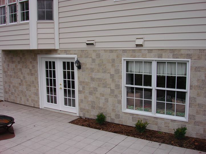 insulated siding with stone siding below.png