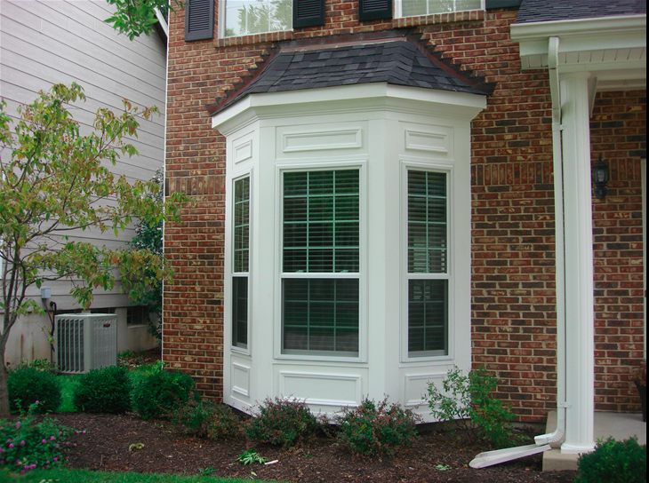 Bay windows with brick siding.png