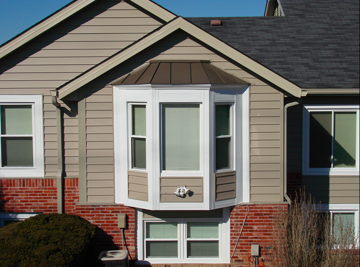 Bay windows on the side of the house.png