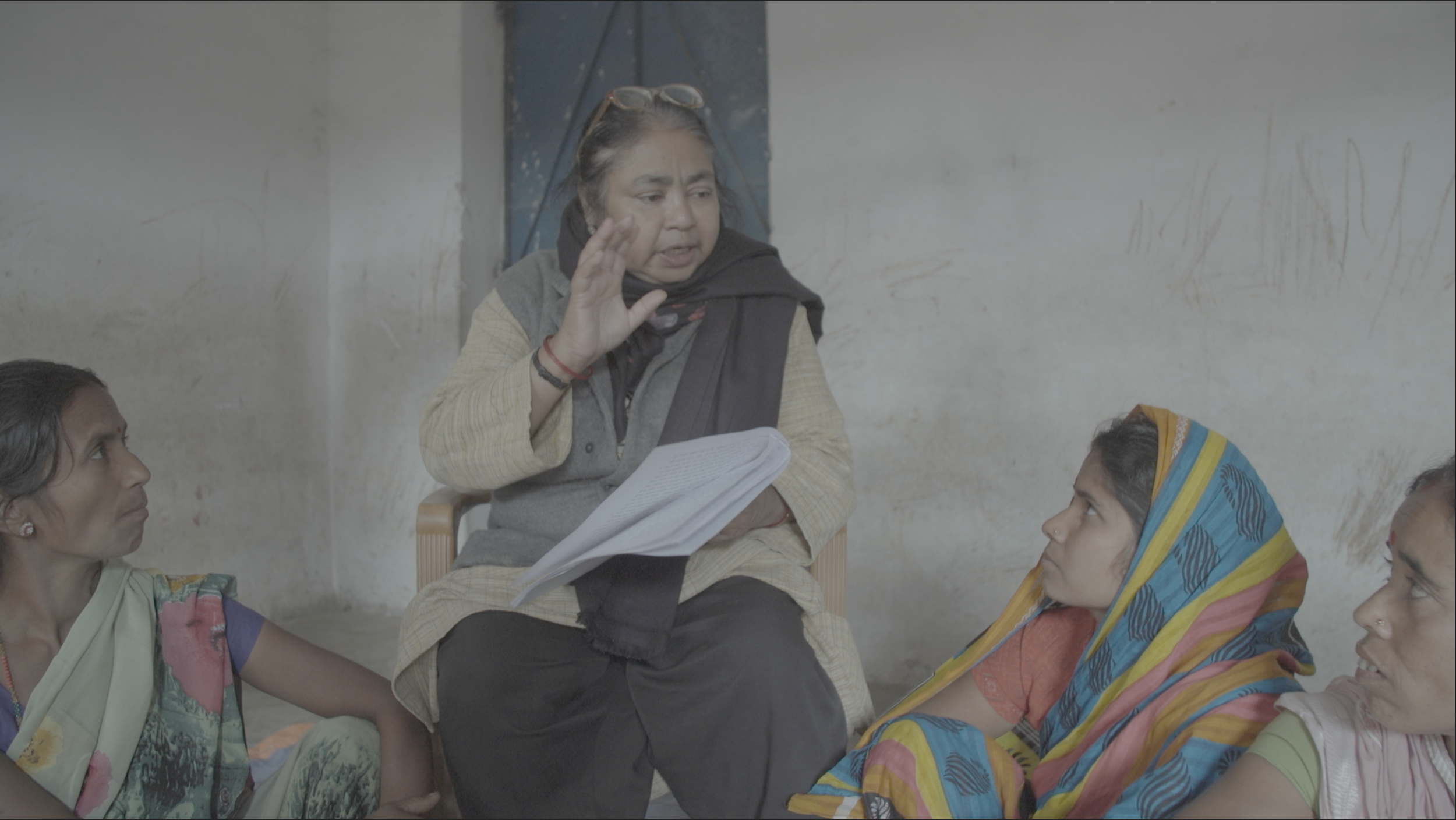 Devika Biswas reading the Supreme Court order to sterilization victims