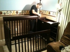 Brett putting together one of the cribs