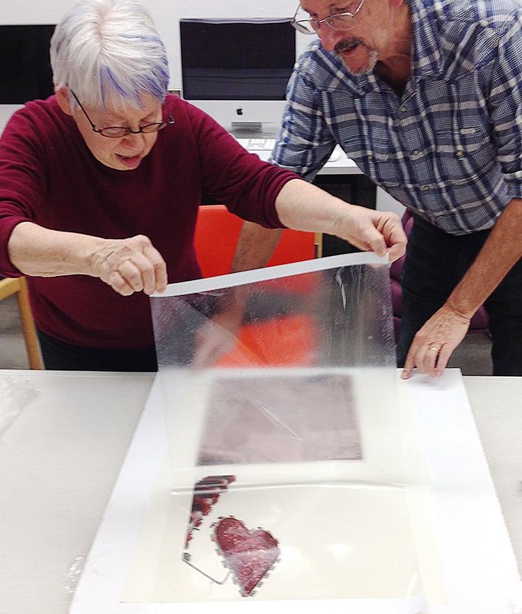 Jane Lederer and Greg Bear transferring an inkjet print to paper using alcohol gel.