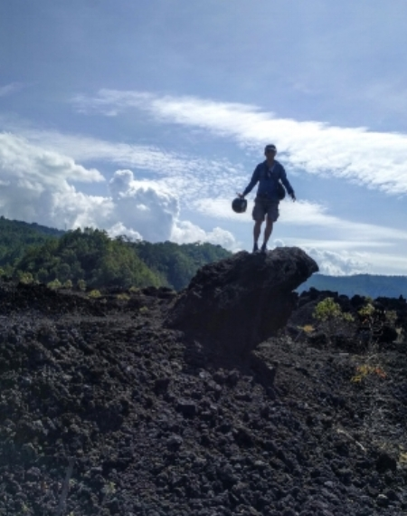 In the lava fields of Mt Batur, one of the holy mountains of Bali. I'm pretending to be free! In reality, it was baking hot in the lava field, and I just wanted to be out of the sun.