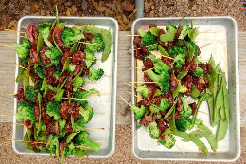 Tamari marinated flank, snow peas, and blanched broccoli ready for grilling