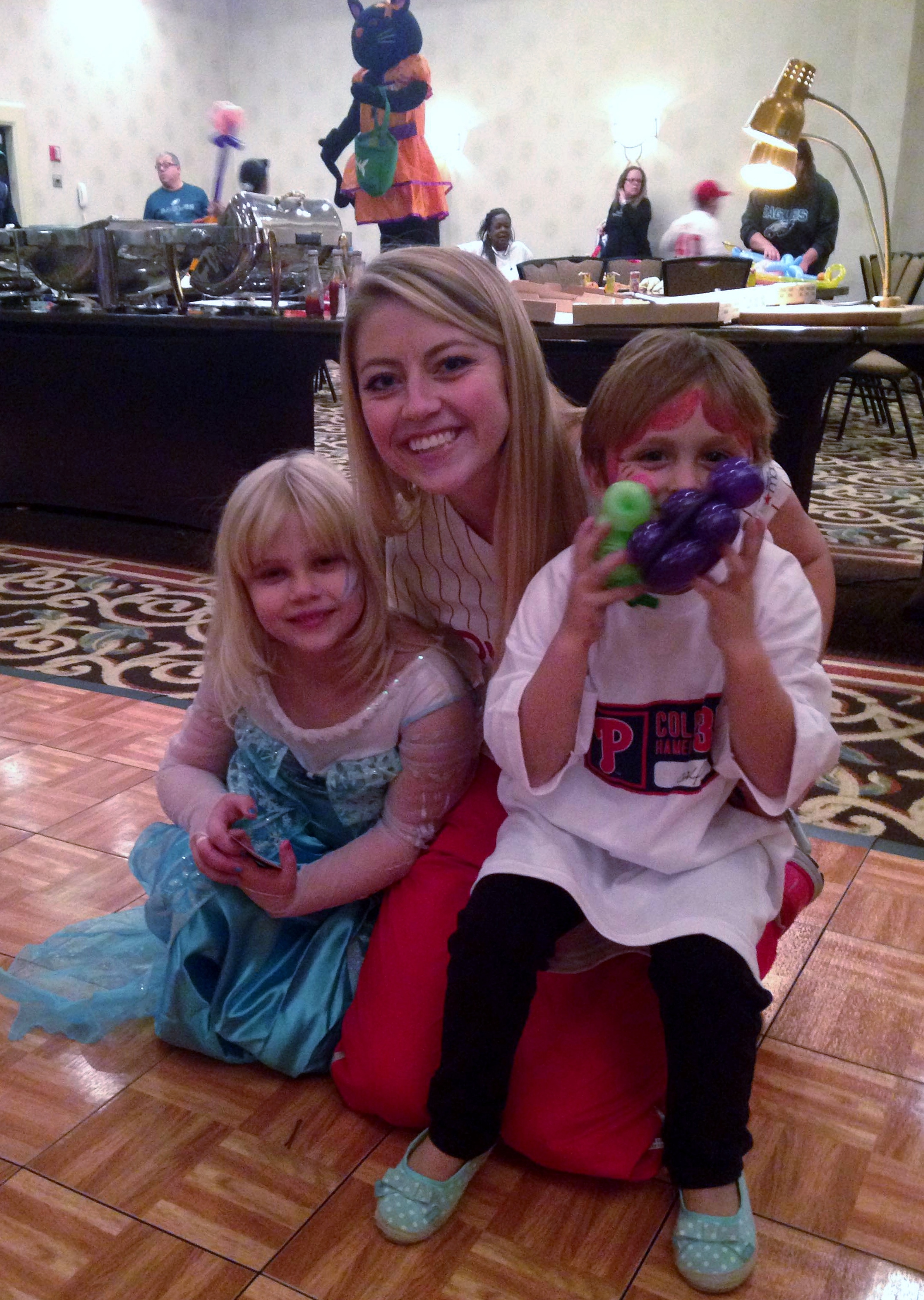 Taylor with kids at the CHOP benefit in October 2014. For more about Taylor's experience, see her favorite memory detailed below!