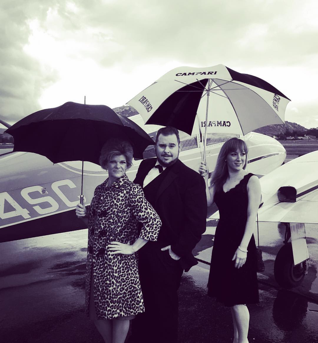 The Ackermans arrive on the tarmac, dressed to kill!