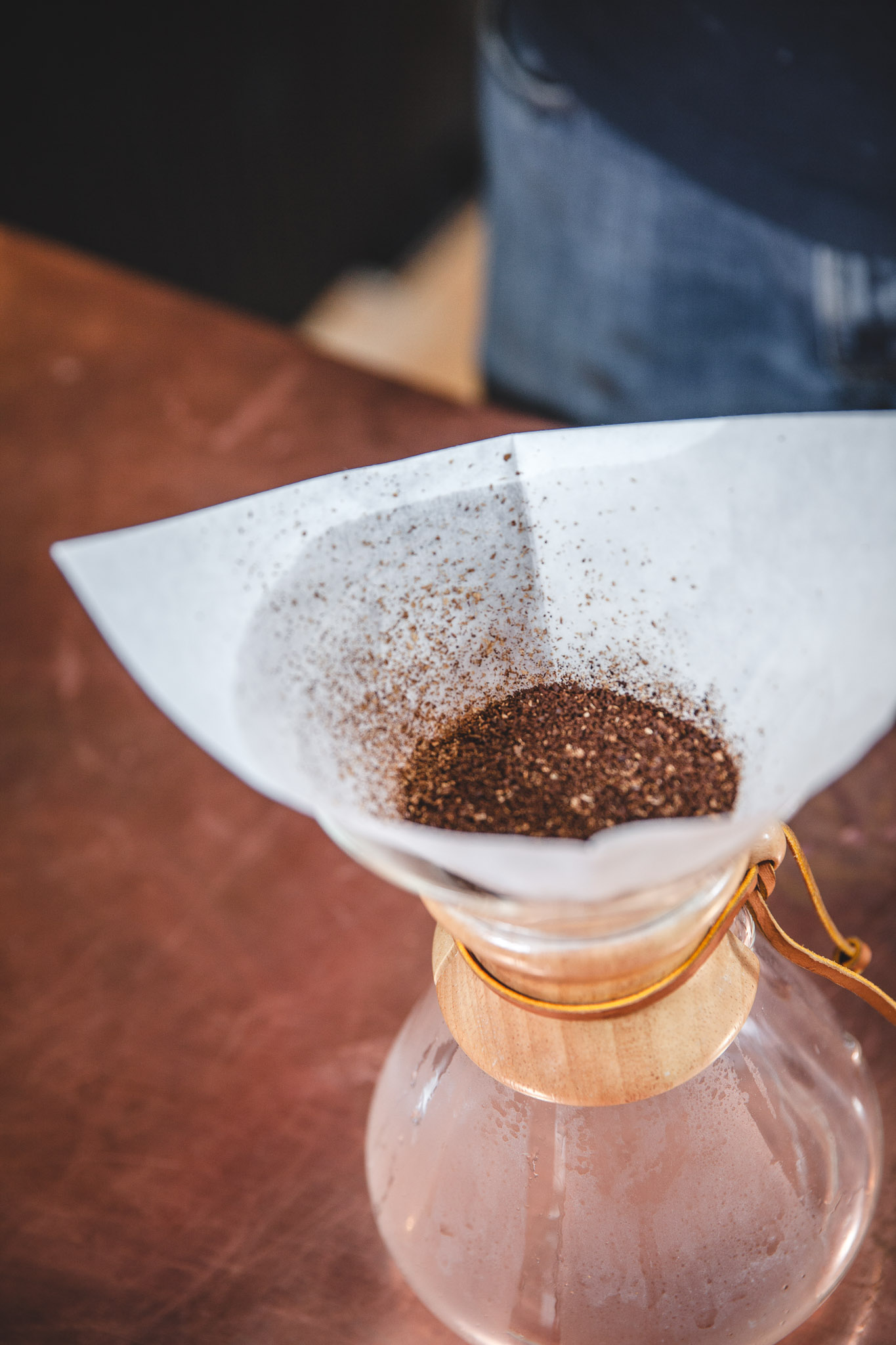 3. Add the ground coffee and gently shake the chemex to flatten the grinds. (This will allow for a more even pour.)