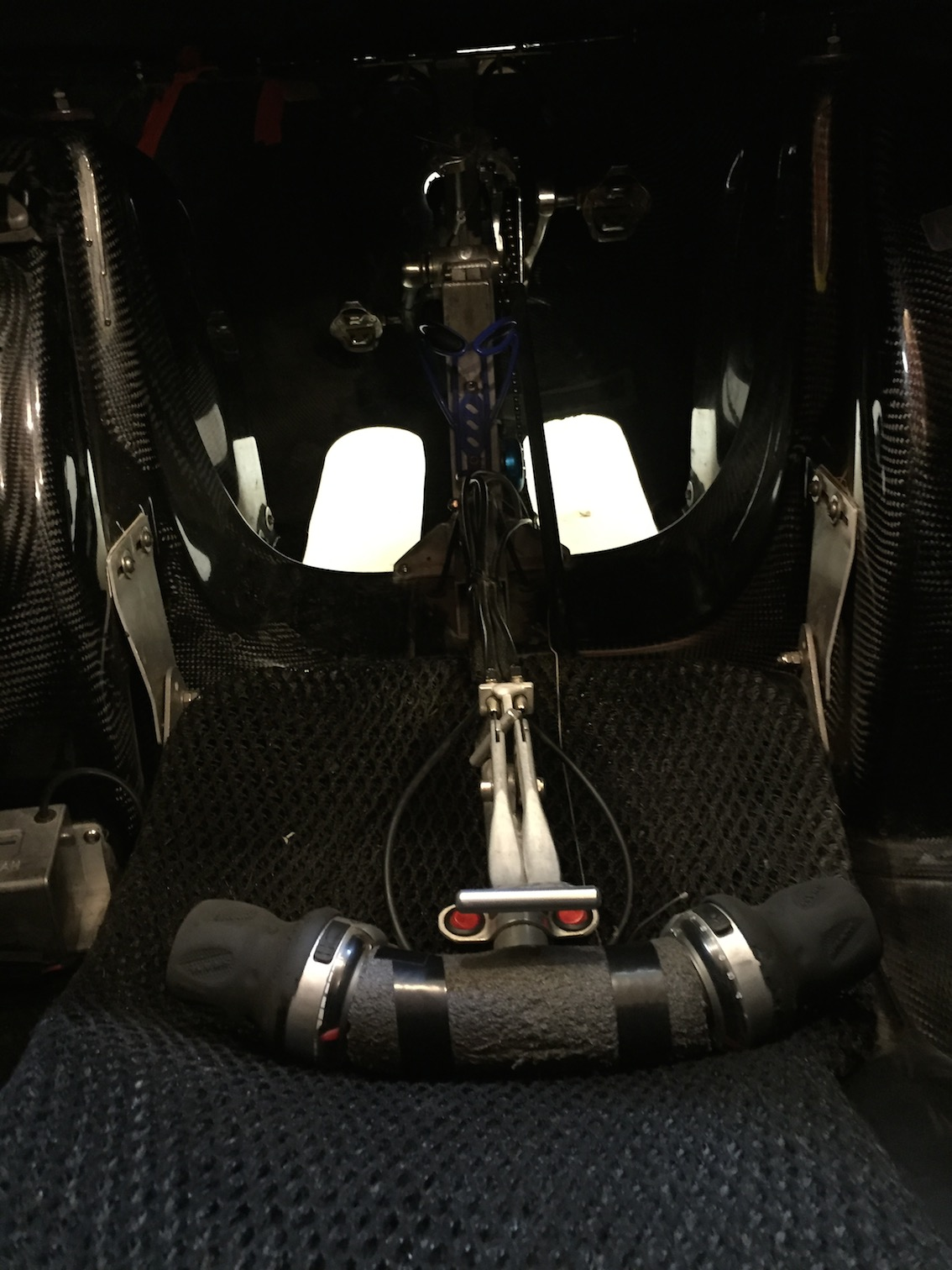 That handle sits on your lap and controls your brakes and signal lights.