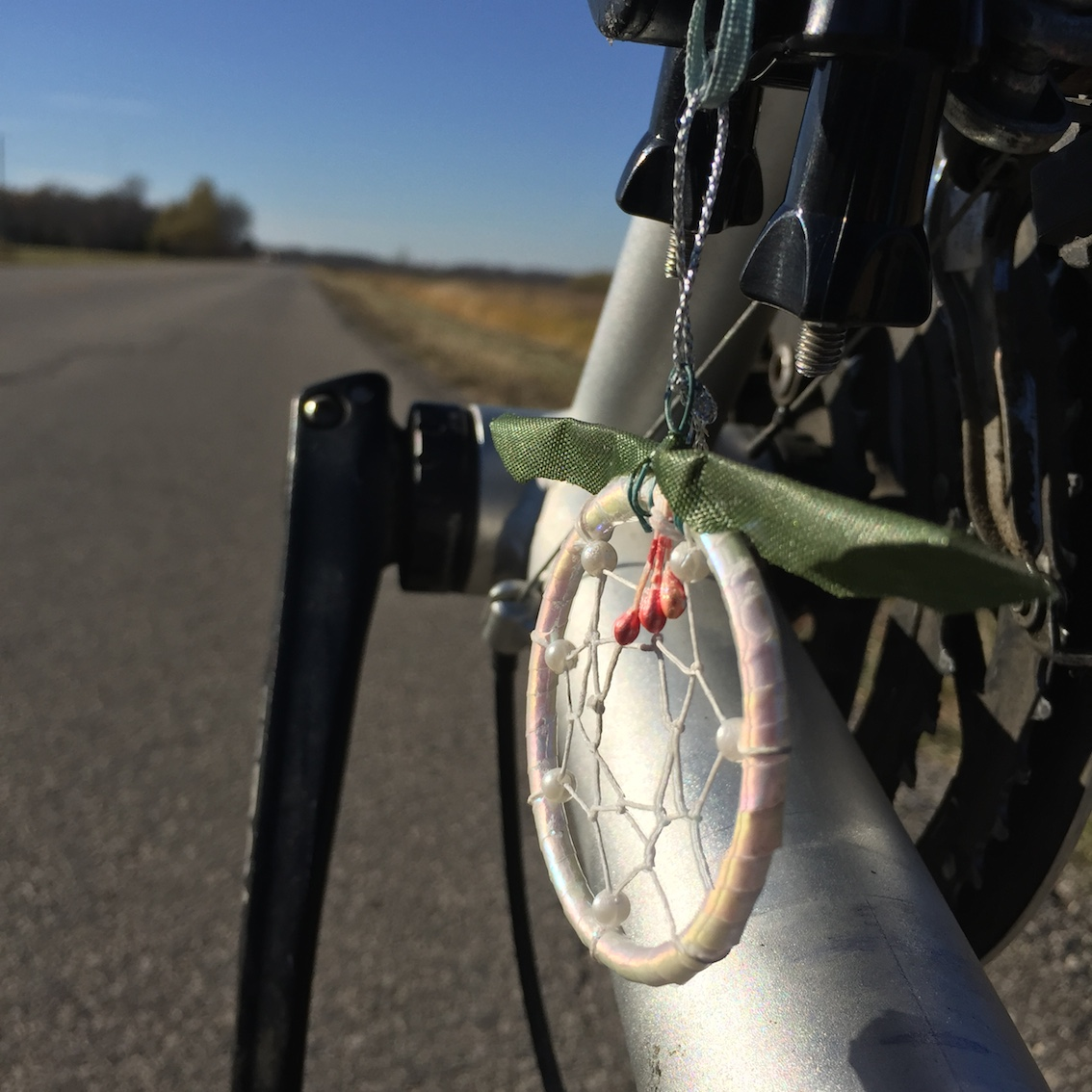 In over 2000 km of highway travel a total of about 4 cars stopped to say hello. I was gifted this wonderful little dream catcher by a kindred spirit as I biked towards Portage la Prairie.