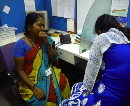 A worker being surveyed as part of CSR strategy development