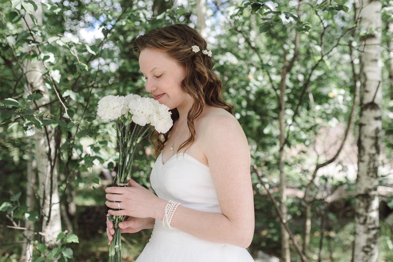 bride smells bouquet flowers