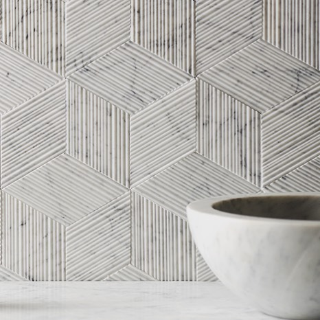 Specifying these tiles for our our Long Island City Project. Bianco Carrara Romboo Tile by @stonesource #marble #geometric #texture