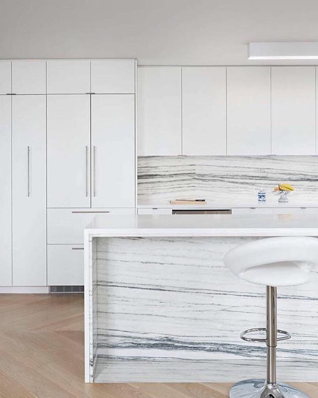 Our Battery Park Project.  Interior Design by Lorenzo Cota / Creative @lorenzocota / Architecture by J_spy / Photo by Amanda Kirkpatrick #interiordesign design #oak #marble #kitchen #nyc