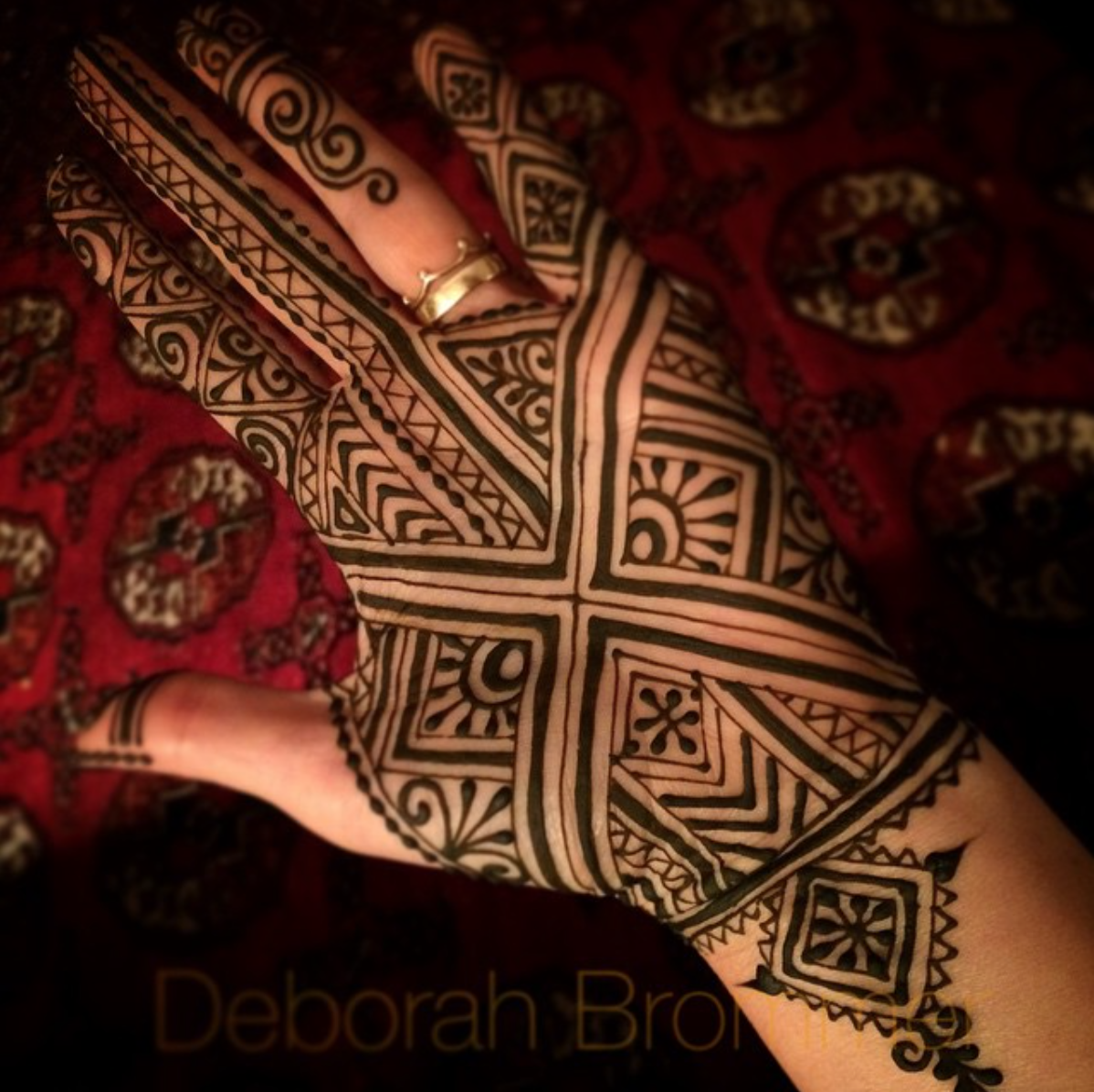 A henna design on the palm of a hand that was inspired by the traditional Moroccan Fezi style of henna.