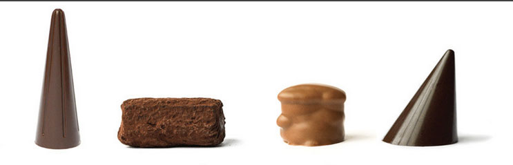 From left to right: the elegant olive oil truffle, whisky truffle, pecan butter crunch, and Douglas Fir
