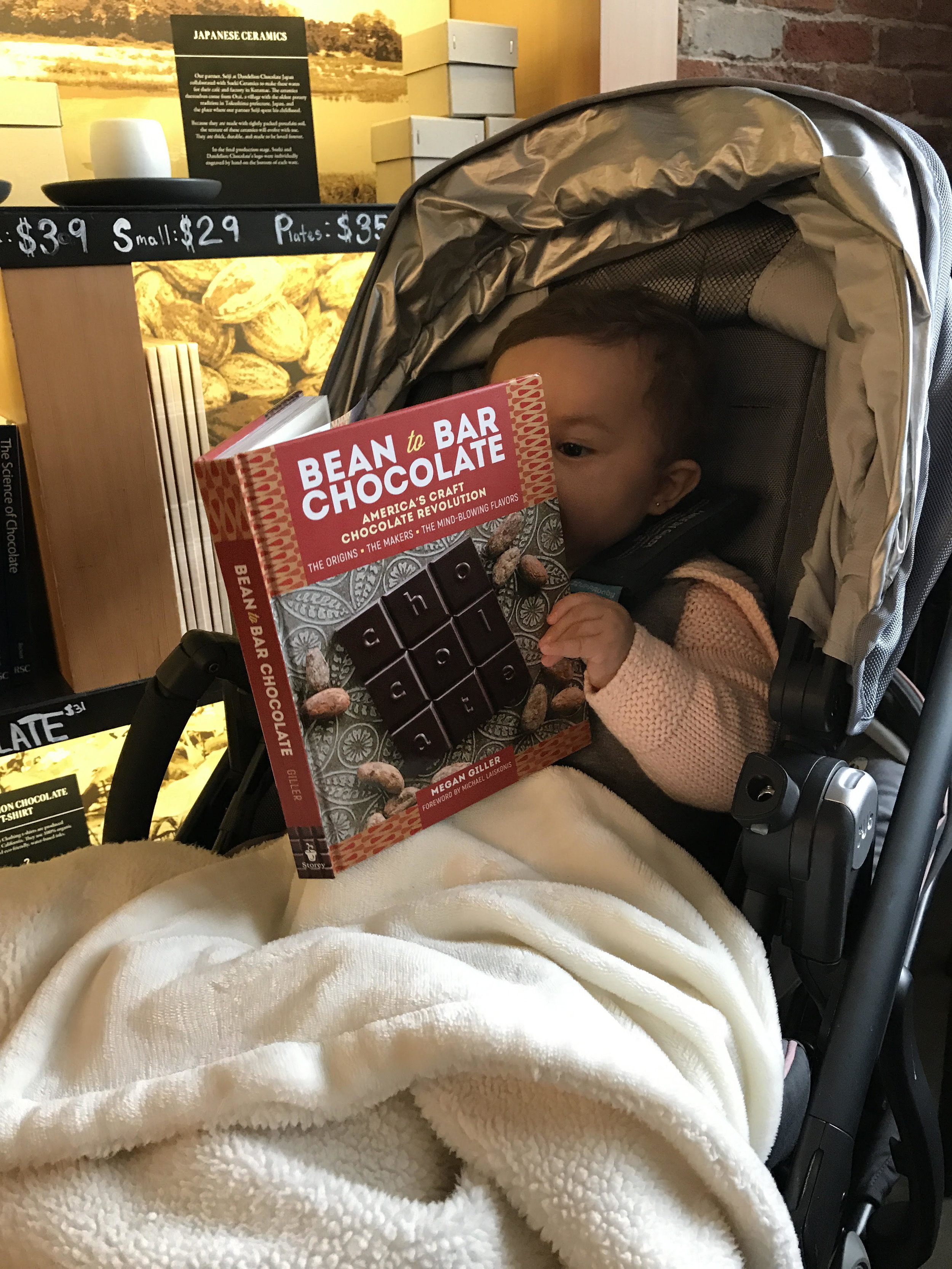 People keep sending me photos of their babies reading my book, and I love it! This is from Arcelia Gallardo, the founder of Mission Chocolate. She says she's been carrying my book around in her diaper bag for easy access.