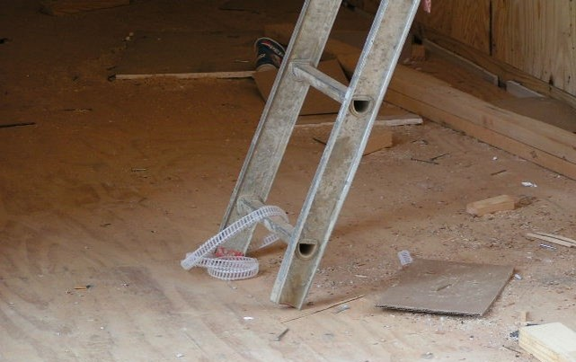 This extension ladder is missing the foot assembly and the foot pads. This appears to be the top portion of an extension ladder that has been taken part. Definitely not safe!
