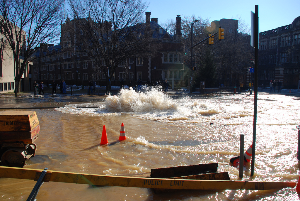 Broken water main flooding this busy intersection. Incidents like this one can be avoided by using safe excavation practices.