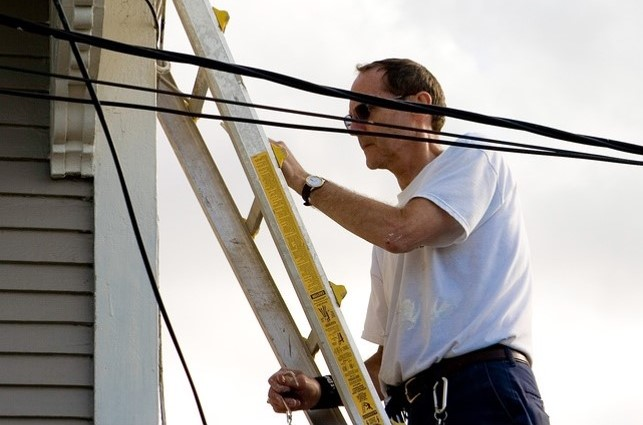 Never use metal ladders when working with or near energized electrical equipment.