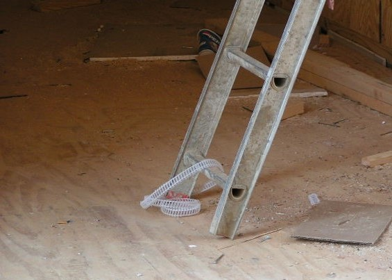 This extension ladder is missing the foot assembly and foot pads. There is nothing stopping this ladder from slipping out from underneath a worker while they are standing on the ladder causing a dangerous fall. This appears to be the top portion of an extension ladder that has been taken apart. (Don't do that.)