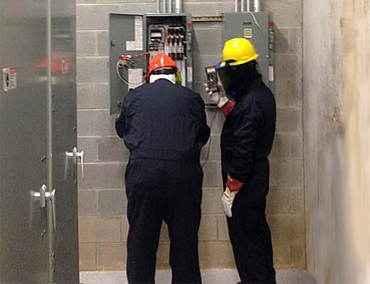 Electrical workers using proper PPE.