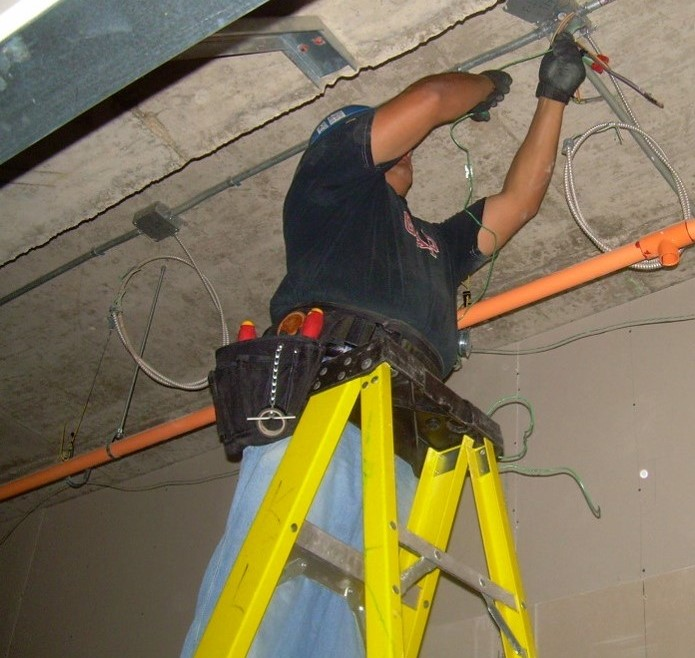 Electrical worker using a step ladder.