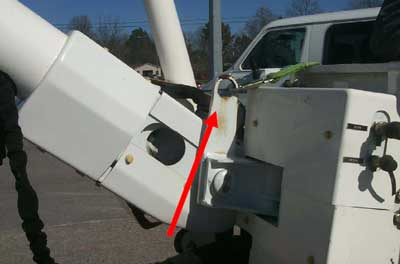 This photo depicts the attachment of the boom to the bucket and the eye hook for the harness attachment.
