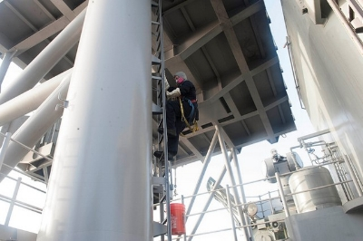 This climber is properly maintaining three points of contact and wearing a personal fall arrest system.