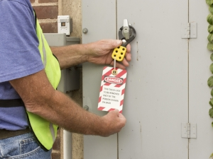 Worker checking the lockout/tagout tags.
