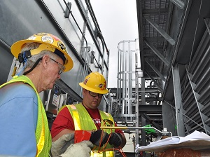 Team members perform a lockout/tagout to safeguard workers from energized equipment during maintenance activities at the evaporative coolers system.