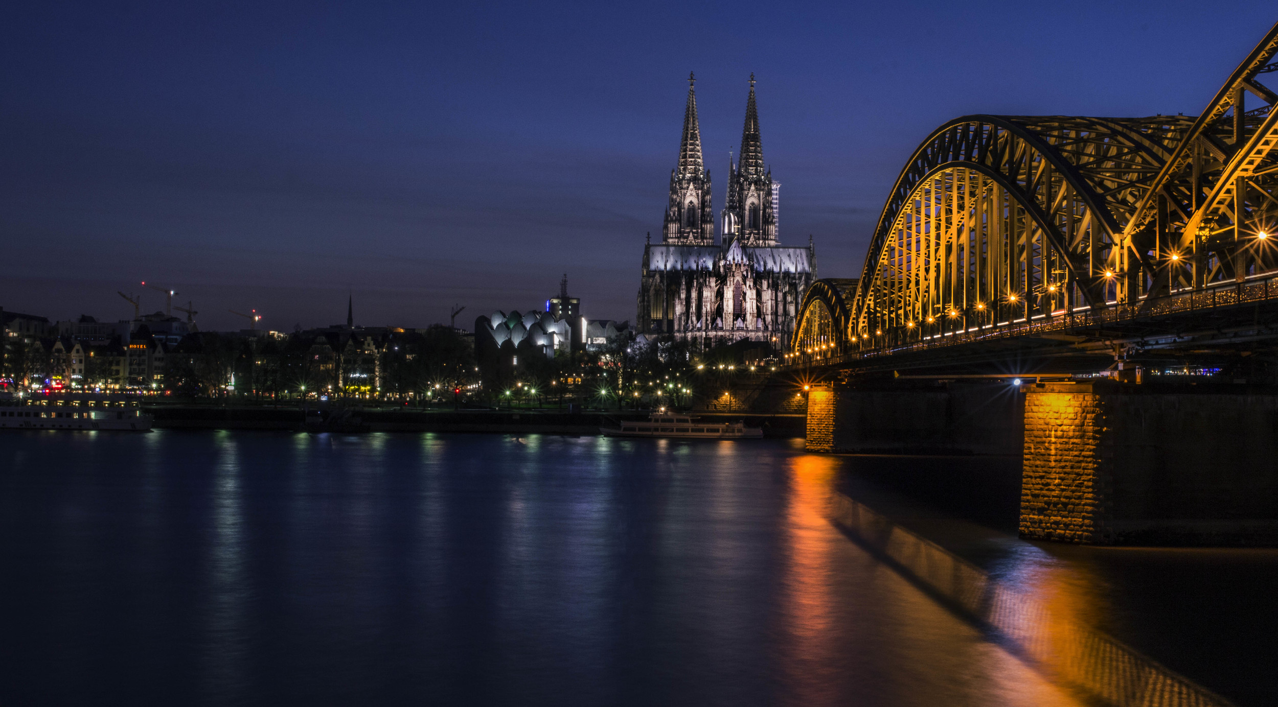 View of the Cologne Cathedral at the Hohenzollern Bridge.