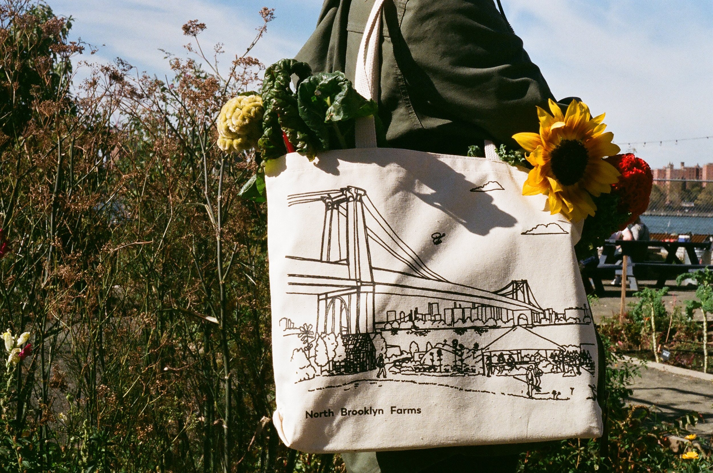 North Brooklyn Farms merch - Members can also receive our signature tote (pictured here) and other limited edition merchandise.