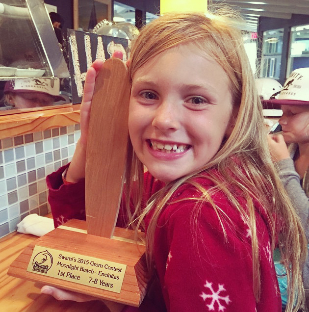 Maile Garrett showing off her 1st place trophy from her first contest!