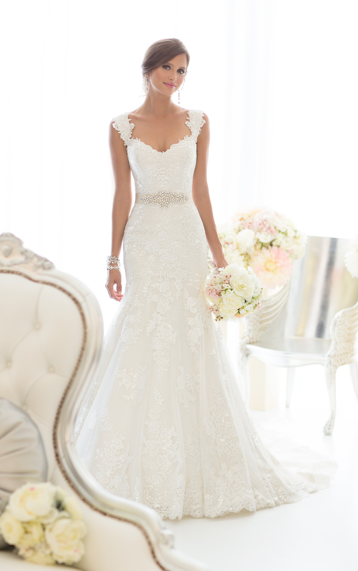 "D1617  — This beautiful all-over Lace fit and flare wedding gown features sparkling Diamante beading throughout and romantic cap sleeves. Comes in ivory or white Lace over a variety of Dolce Satin underdress color choices. Customize your gown to best reflect your sophistication and unique style with the included 1.5"" Grosgrain ribbon sash in your choice of natural, white, orchid, topaz, blossom, bisque or black.  Colors Available: Ivory/Ivory, Ivory/Oyster, White/White"