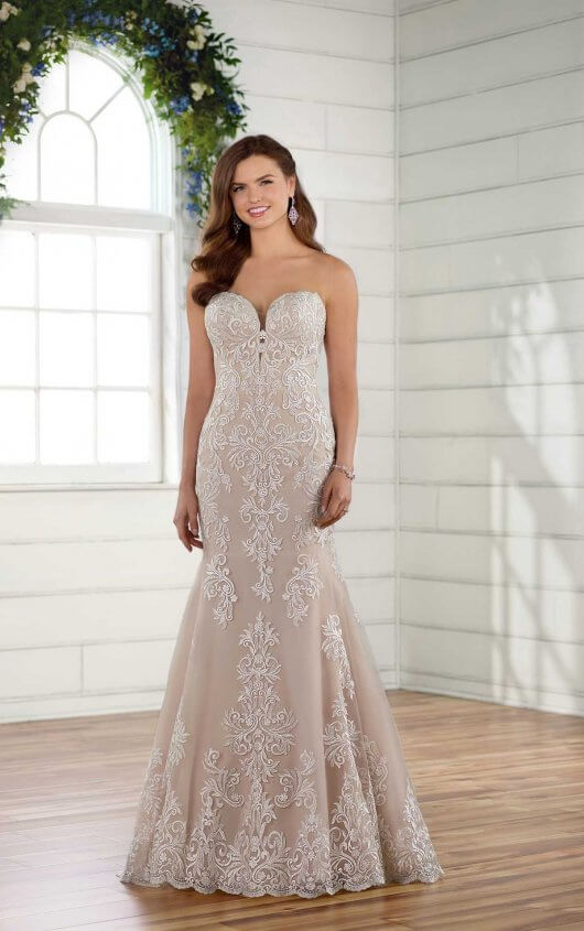 D2424 - Bring your vintage-inspired dreams to life in this breathtaking lace wedding dress from Essense of Australia. Featuring a romantic sweetheart neckline, the ornate lace pattern of this gown continues from the neckline down through the hips of this slight fit-and-flare gown. From there, the lace detailing spaces out, and is more concentrated in the front of the dress, finishing perfectly around the hem. Through the back of the gown, the bodice becomes sheer, adding a flirty element to this otherwise classic and sweet design. A breathtaking lace-hemmed train completes the look effortlessly. The back of this vintage lace wedding dress zips up beneath pearl buttons and is available in plus sizes.  Colors Available - White, Ivory, Ivory/Moscato