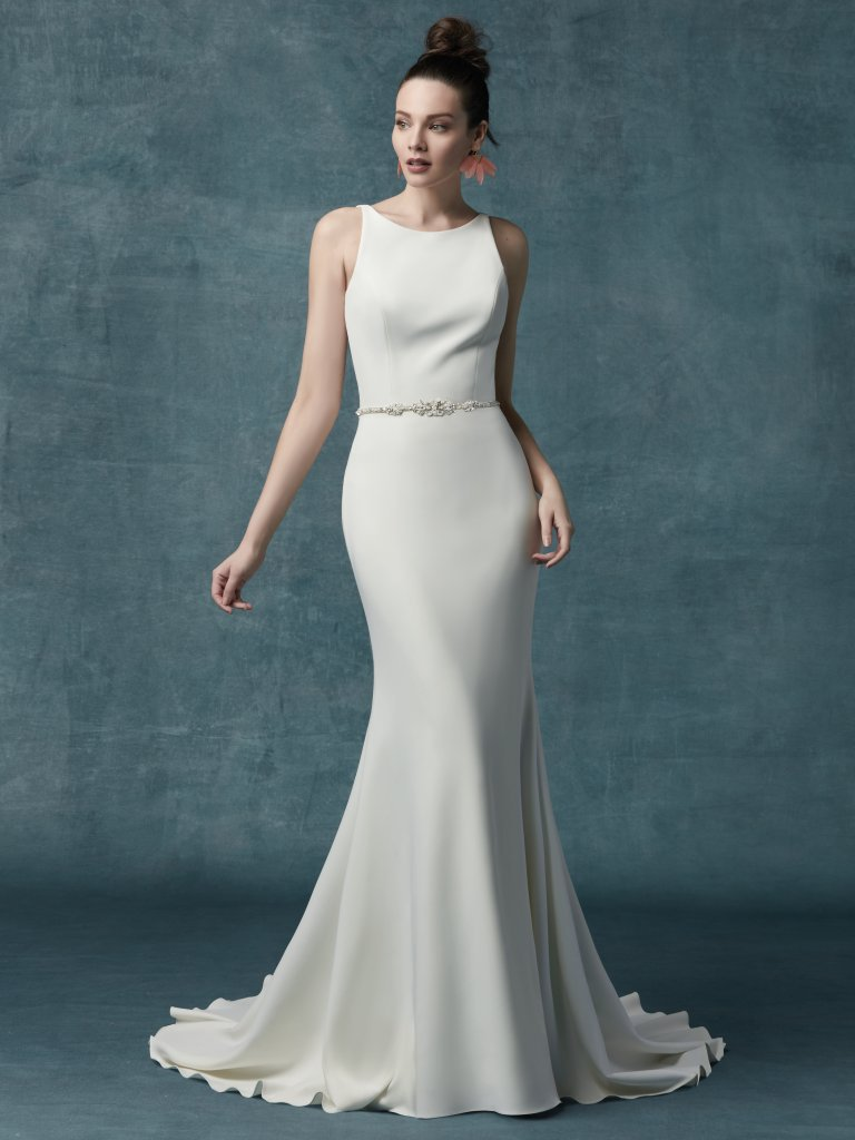 Claudia Dawn -   This chic and simple wedding dress features allover Aldora crepe in a sheath silhouette. Elegant straps complete the jewel neckline and square back. Finished with zipper closure. Illusion tulle jacket accented in embroidery  faux feathers and belt sold separately     Available in - Ivory