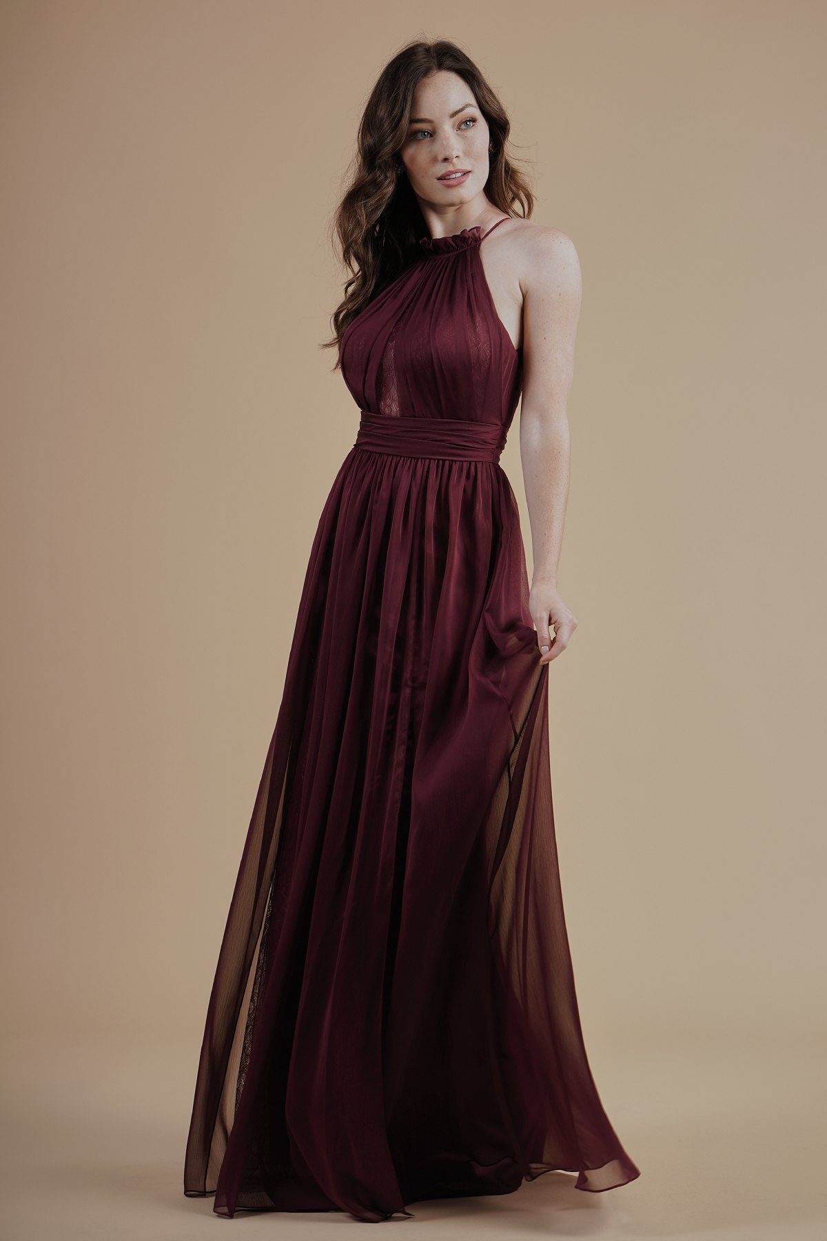 L214004 -  Gorgeous Belsoie Tiffany Chiffon and lace floor length bridesmaid dress with a beautifully ruffled high neckline. A lace back bodice, lace detail on the bodice, and detailed gathers throughout the dress.      Available in 16 colors