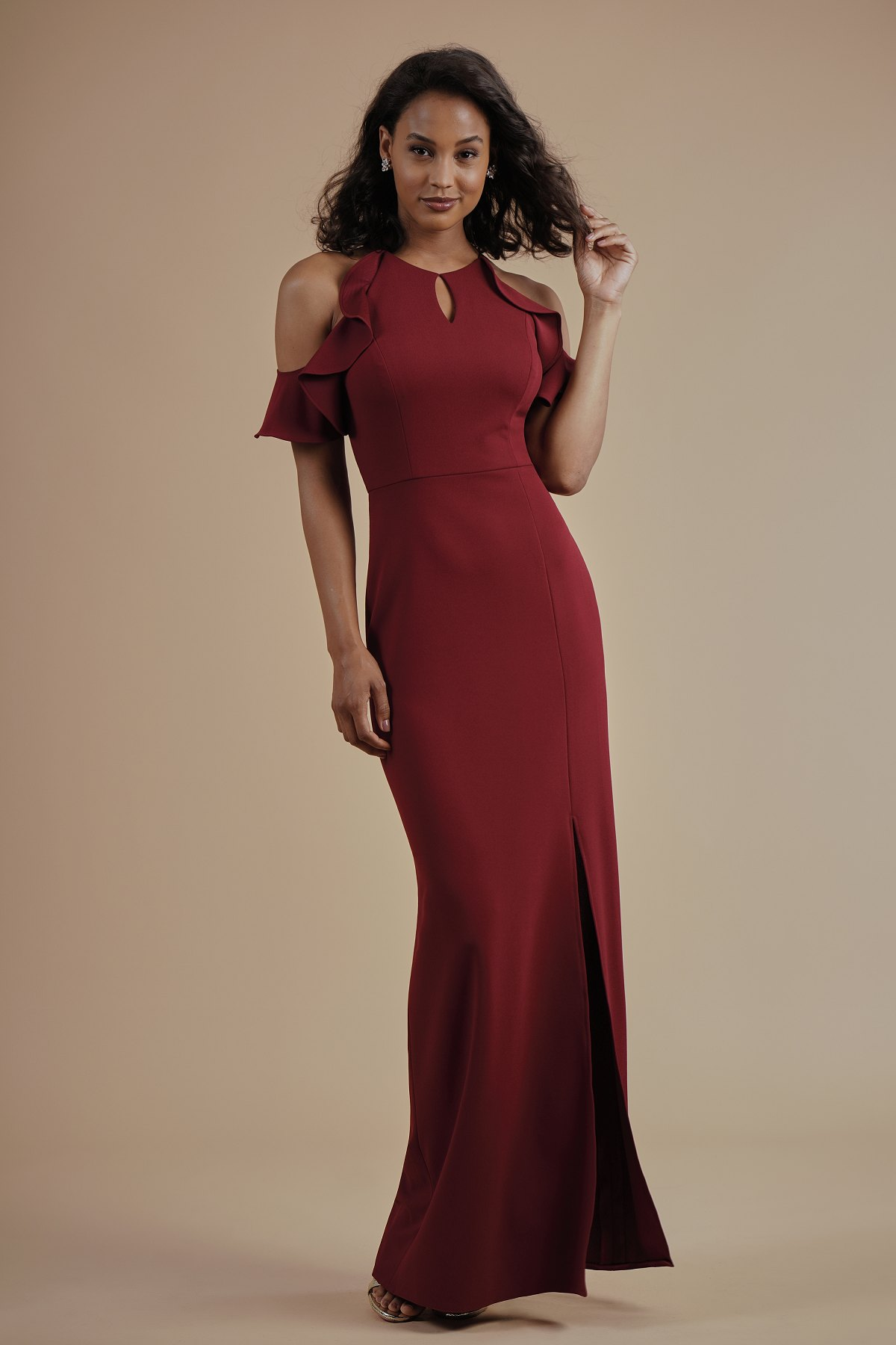 L214014 -  Pretty stretch crepe floor length bridesmaid dress with a jewel neckline and keyhole design. A high neck back, cold shoulder ruffled sleeves, and a front slit to complete the look      Available in 21 colors