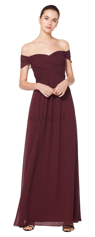 7071 -  Chiffon off the shoulder sweetheart gown. Criss-cross ruched pleated bodice with ruched cap sleeves. Soft front gathers adorn the A-line skirt.    Available in 43 colors