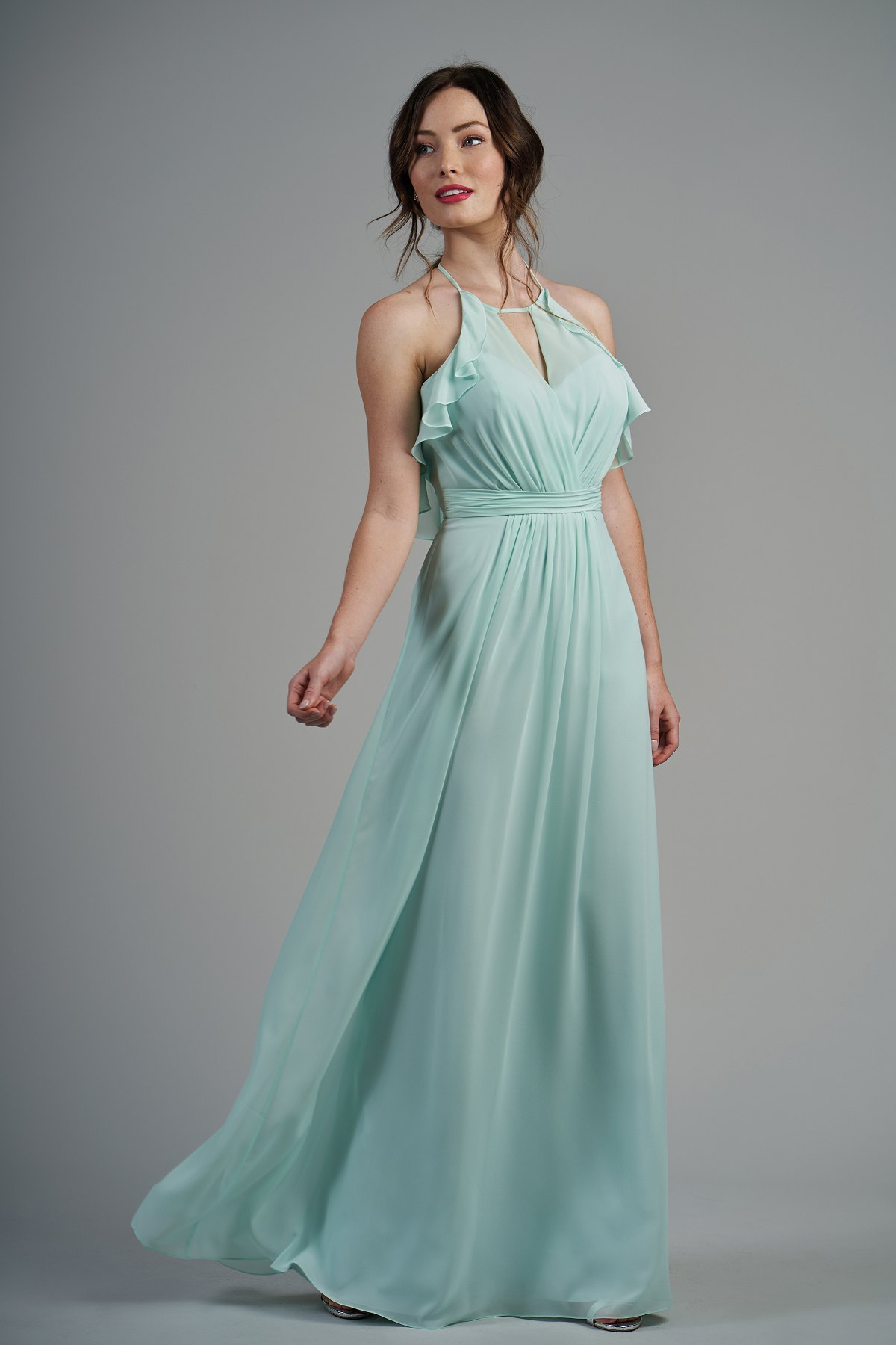 B213001 -  Pretty poly chiffon floor length bridesmaid dress with a keyhole jewel neckline and low V back. Beautiful ruffle details on the bodice and detailed gathers throughout the dress.    Available in 60 colors