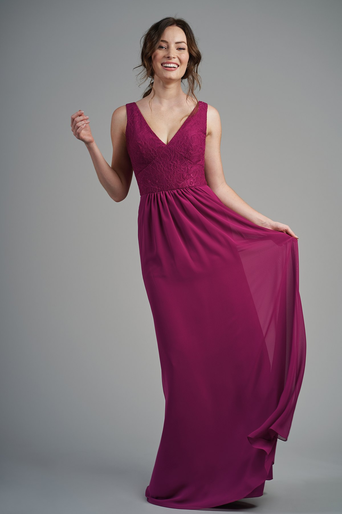 B213011 -  Simple lace and poly chiffon floor length bridesmaid dress with a flattering V-neckline and V back. Beautiful detailed gathers on the skirt to complete the look.    Available in 22 colors