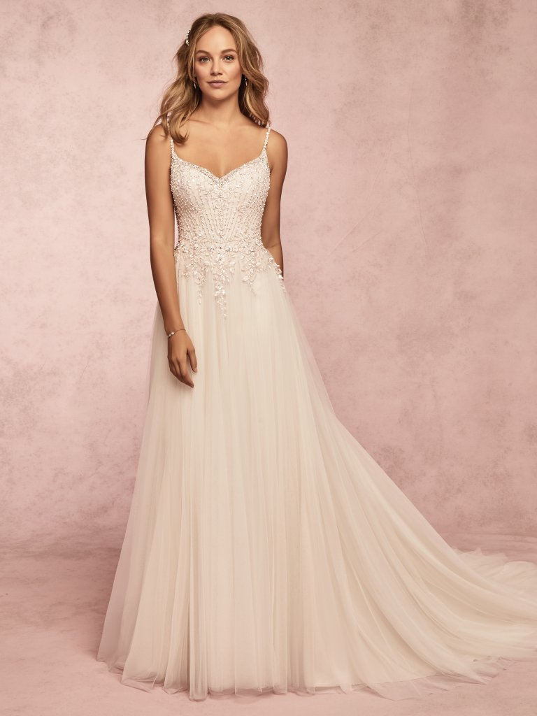 Mayla -  Geometric lace motifs and Swarovski crystals adorn the bodice of this vintage-inspired wedding dress, cascading into a tulle A-line skirt. Shimmering beads adorn the spaghetti straps, sweetheart neckline, and back. Finished with covered buttons over zipper closure.    Available in: Ivory/Pewter, Ivory/Soft Blush/ Rosegold