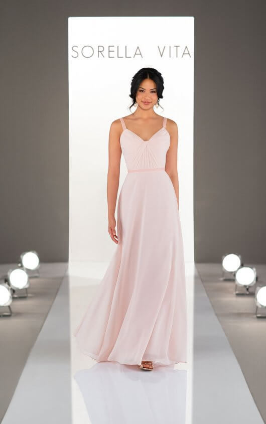 9230 -  Your bridal party will turn heads in this stunning bridesmaid dress from Sorella Vita! The elegant sheath silhouette features multi-directional ruching along the bodice to contour the curves, as the breezy chiffon skirt floats down the aisle for an effortless finish. To top it all off, velvet accents adorn the waistline and straps for a simple touch of luxury.    Available in 33 colors