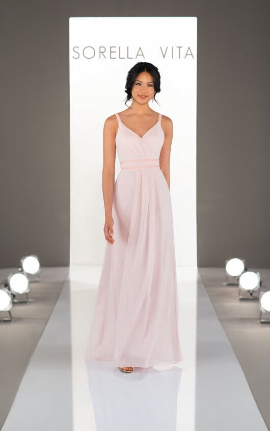 9250 -  Chic, modern and sexy—with a twist! A classic sheath silhouette with subtle sweetheart neckline, this chiffon bridesmaid gown features a double velvet waistband that creates an enviable feminine shape—while velvet straps grace the shoulders for a subtle sexiness. Sleek and totally on-trend, bridesmaids will love rocking this mixed-material gown again and again—on the wedding day and beyond!    Available in 33 colors