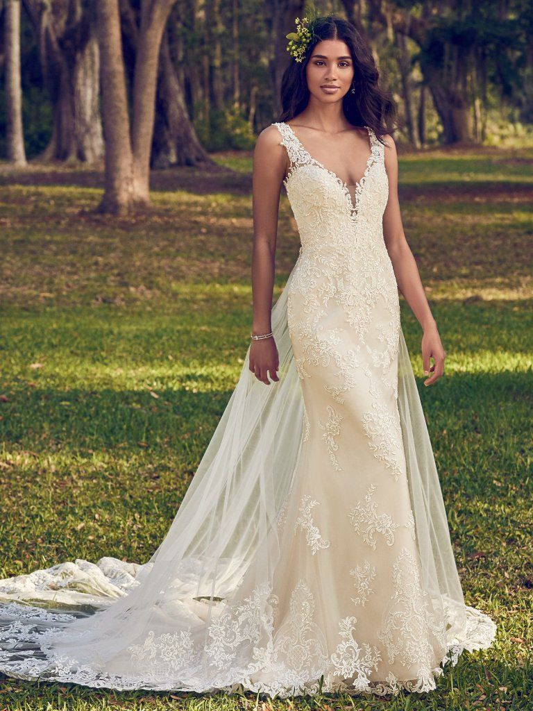68664e27ff12 Bernadine - Beaded lace motifs dance over tulle in this sheath wedding dress,  accenting the