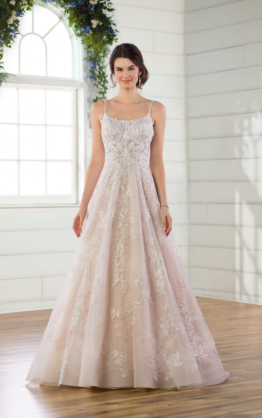 D2843 -  High necklines are back and better than ever, especially with this young and fresh approach to the classic ballgown from Essense of Australia. Nature-inspired laces shower over the silhouette, creating a somewhat scalloped look along the straight-across neckline and playing up the multi-layered skirt of tulle and Regency organza. Soft sequins twinkle along the skirt, with horsehair finishing for structure and shimmer. The shoestring straps extend through the back of the bridal gown into a multi-strap feature over the low, open back–zipping closed beneath fabric-covered buttons before flaring into the full skirt. Also available in plus sizes, this on-trend wedding dress features a slight train for a luxe yet laid-back finish.    Available in: White, Ivory, Ivory/Moscato
