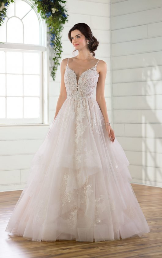 D2893 -  Classic, dreamy and totally timeless, this ballgown was made for the modern-day romantic bride. Multiple laces create a densely layered look along the bodice for a rich texture, complementing the plunging neckline and shoestring straps to highlight the face–following into a triple-strap feature around the open back for a breathtaking simplicity. The bodice also features a sheer detail in back for a hint of sexiness at every angle, before flowing out into the textured skirt of layered tiers for a fun and flirty element to this utterly feminine ballgown. The short train completes the look with a subtle finish. This wedding dress is also available in plus sizes.    Available in: White, Ivory, Ivory/Moscato