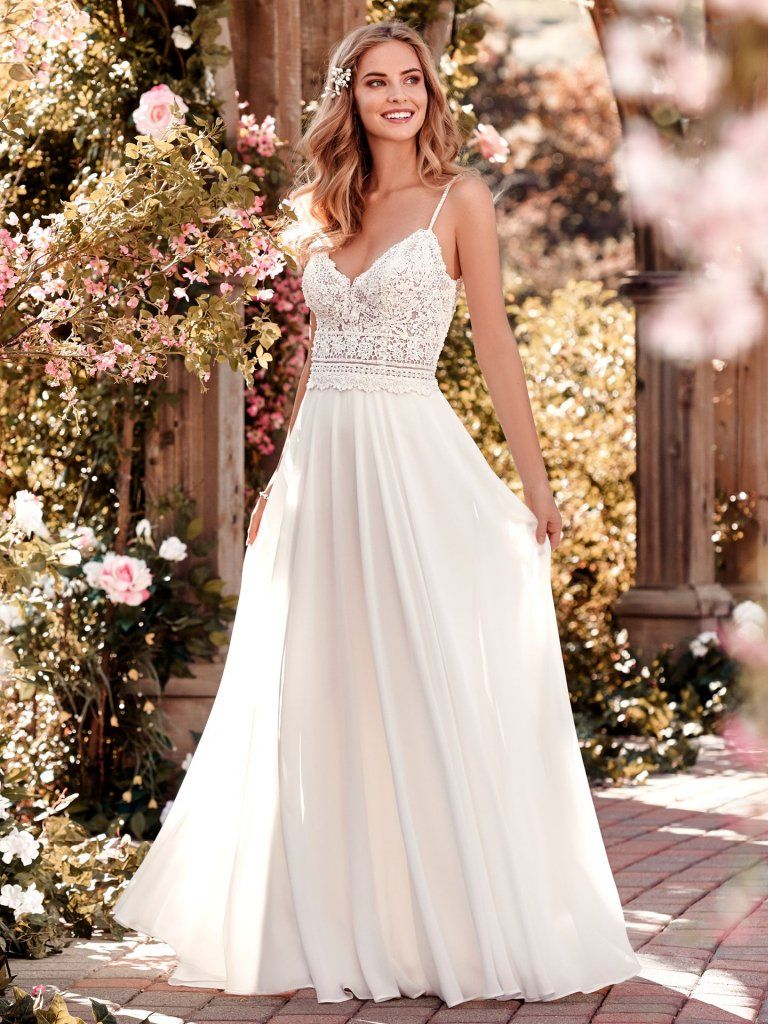 Juniper -  This chiffon boho-inspired wedding dress features a sheer bodice accented in beaded lace atop an Aria Chiffon skirt. A V-neck, V-back, and beaded spaghetti straps complete this sheath gown. Finished with crystal buttons and zipper closure. Available in plus size.    Available in: White, Ivory